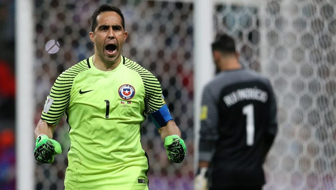 Chile's goalkeeper Claudio Bravo reacts during a shootout win over Portugal during the Confederations Cup semifinal.