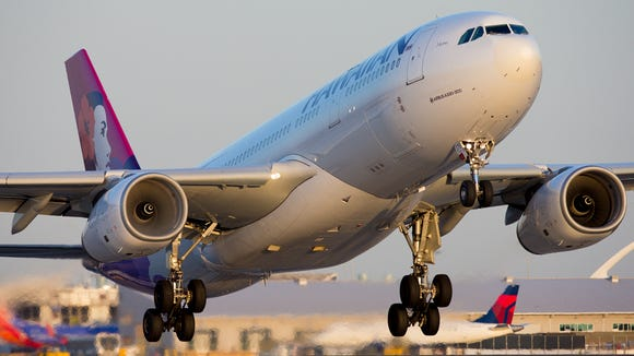 A Hawaiian Air Airbus A330 takes off for Honolulu from