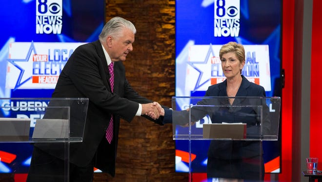 The two main Democratic candidates in the Nevada race, Steve Sisolak and Chris Giunchigliani, appear   at a recent debate.