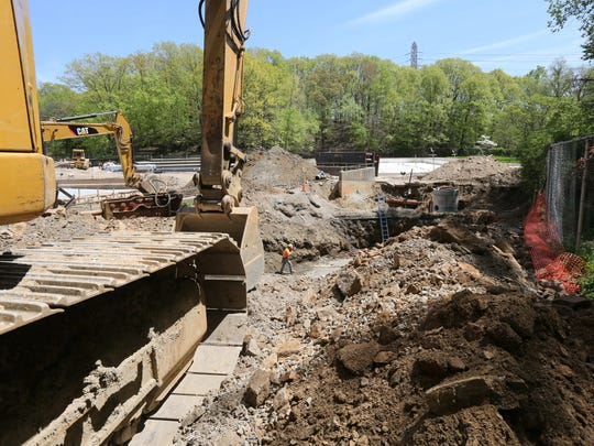 Construction continues on one of the pools at Sprain