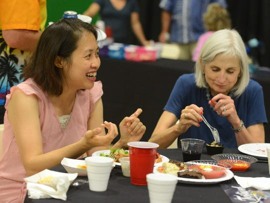 Jiachi Huang, a violinist with the Lancaster Festival Orchestra laughs as she has dinner with Cynthia Pearsall, Tuesday, July 19, 2017, at Ohio University Lancaster. During the festival Huang stays with Pearsall and her husband Art Pearsall. She's been staying with the Pearsalls for 16 years.