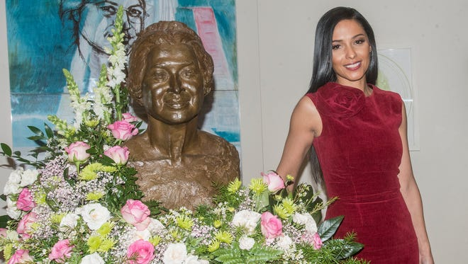 "Meta Golding stands next to a bust of Rosa Parks, whom Golding plays in a new movie. The first official screening of TV One's film ""Behind the Movement"" was shown to a packed house Thursday, Feb. 1, 2018, in the auditorium of the Rosa Parks Museum in Montgomery, Ala. The film on Rosa Parks and the Montgomery Bus Boycott will air Feb. 11 on TV One."