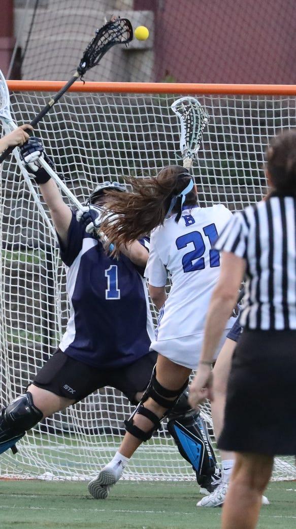 Bronxville's Alex Doukas shoots on Putnam Valley goalie