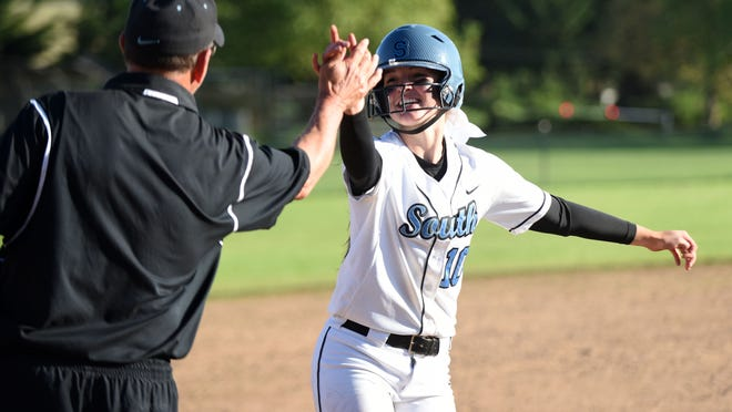 South Salem's Maygen McGrath rounds the bases after hitting a home run as the Saxons defeat Sprague 7-6 in the second round of the OSAA Class 6A state playoffs on Wednesday.