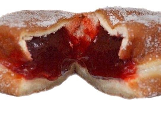 Pączki, Polish donut-like pastries with fruit filling,