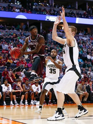 Little Rock Trojans guard Josh Hagins (3) flies to the hoop against Purdue Boilermakers defenders during Purdue vs Arkansas Little Rock in the first round of the 2016 NCAA Tournament at Pepsi Center.