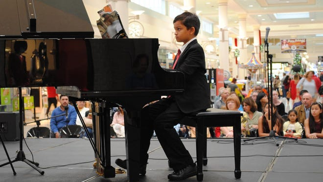 Nolan Bennett performed piano selections.