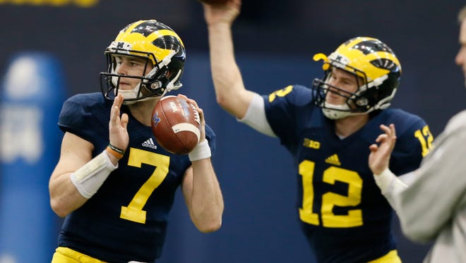 Michigan quarterbacks Shane Morris, left, and Alex Malzone in practice March 19, 2015.