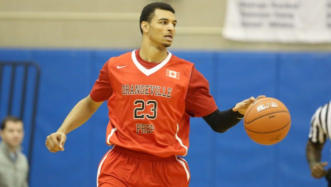 Orangeville Prep's Jamal Murray #23 in action against Phelps Academy during their Big Apple Basketball Classic high school basketball game in Manhattan, NY on Saturday, January 17,  2015.