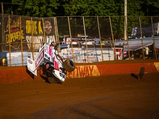 Driver Shane Stewart collides with the wall Thursday