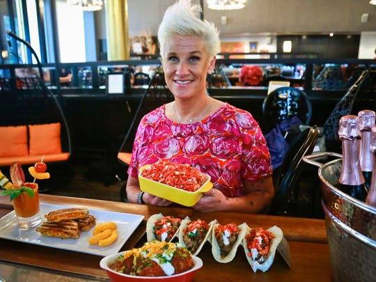 Food Network star Anne Burrell shows off some of her