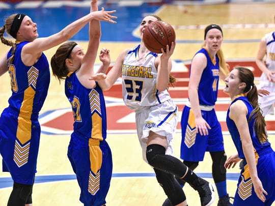 Cathedral's Megan Voit drives to the basket during the second half of the Tuesday, March 7, Section 6-2A playoff game at St. John's University in Collegeville