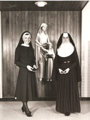 Sisters of Mercy original habit, right, and simplified habit in the late 1960s.