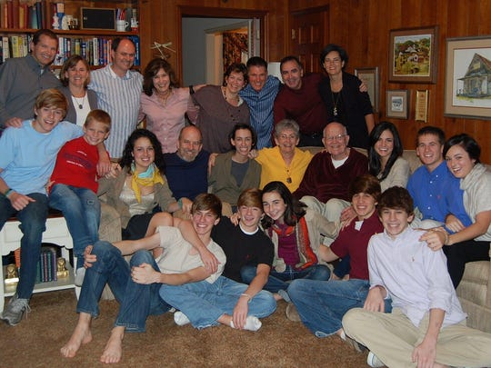 John D. Graham with wife Faye, center, and their family at Thanksgiving in 2010.