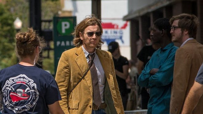 """Actor Ewan McGregor walks across Seventh St. in downtown Cincinnati during the first day of filming for Don Cheadle's """"Miles Ahead."""""""