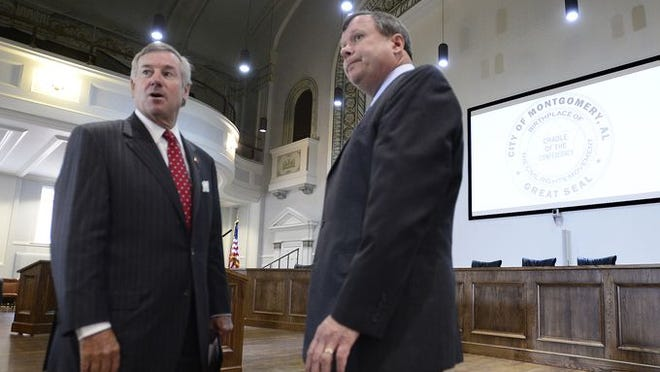 Montgomery Mayor Todd Strange and Police Chief Kevin Murphy chat before a news conference in the city hall auditorium in Montgomery, Ala. on Monday June 23, 2014.