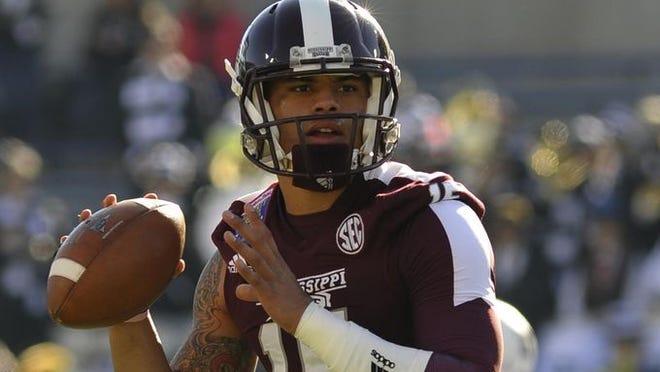 Mississippi State and quarterback Dak Prescott (15) start practice Thursday.