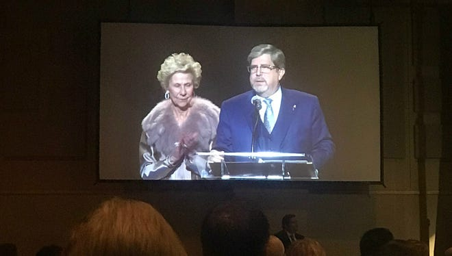 Elta Joyce Murphey McAfee, the 2017 Citizen of the Year, applauds Rick Mantooth, recipient of the San Angelo Chamber of Commerce's 2018 Citizen of the Year.