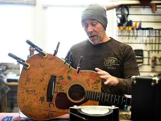 Creter Guitar Shop owner, Matt Creter, focuses on a