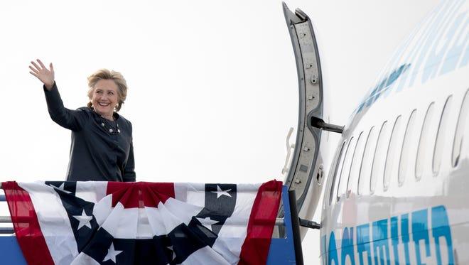 Democratic presidential candidate Hillary Clinton boards her campaign plane at Pueblo Memorial Airport in Pueblo, Colo., Wednesday, Oct. 12, 2016, to travel to Las Vegas.