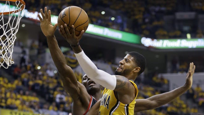 Indiana Pacers forward Paul George (shooting around Toronto Raptors center Bismack Biyombo), says he'll rely on his teammates more going forward.