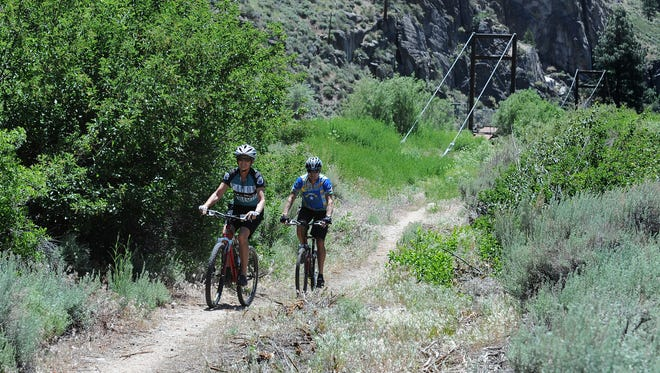 Janet Phillips, front, and Mike Phillips ride along the  Tahoe Pyramid Bikeway in 2013.