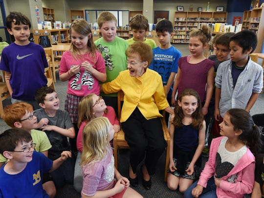 Evelyn Hackler talks with students Wednesday at Hackler Intermediate School. Most students knew the school was named after Evelyn and her late husband Robert.
