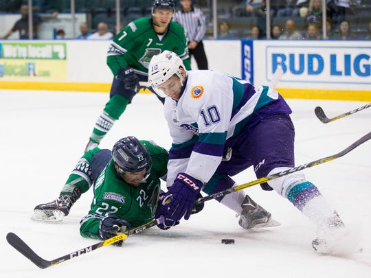 The Everblades' Mike Ferrantino (22) and the Solar Bears' Jon Jutzi (10) get tangled up while battling for the puck during the third period of Game 2 of the Kelly Cup Playoffs, South Division semifinals at Germain Arena Friday, April 14, 2017 in Estero, Fla. Orlando would win 3-2 to take a 2-0 series lead.