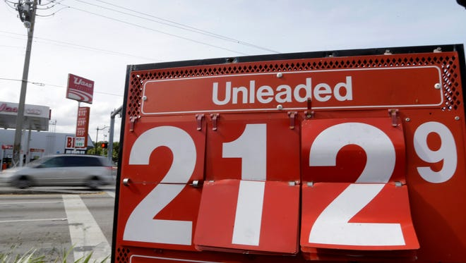 The price of unleaded gasoline is displayed at a Westar gas station, Friday, Jan. 23, 2015, in Miami. Analysts are expecting lower gas prices to contribute to strong fourth quarter results for retailers.
