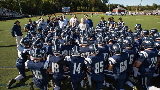 Exeter High School football coach Bill Ball addresses his team following a game last season. Football and all other fall sports and extracurricular activities will return at EHS after the school board's near-unanimous vote on Tuesday night.