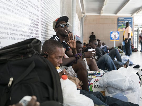Haitian migrants line the floor of the DeConcini port of entry in Nogales, Sonora, hoping to speak with U.S. Customs and Border Protection officers on Oct. 23, 2016. Larger numbers of Haitians, coming from Brazil, have been arriving at ports in hopes of entering the U.S. on humanitarian parole.  After a wave of migrants from Central America arrived, U.S. Immigration and Customs Enforcement officials have released 900 Haitian nationals due to a lack of detention space.