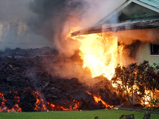 Flames started by lava consume a house in the Leilani Estates neighborhood on May 6, 2018, near Pahoa, Hawaii.