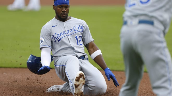 Kansas City Royals DH Jorge Soler (12) slides safely in to third base against the Detroit Tigers during the first inning Thursday. The Royals went on to a 5-3 victory.