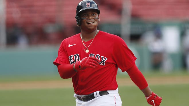 Boston Red Sox third baseman Rafael Devers reacts after grounding out during the ninth inning of a baseball game against the Toronto Blue Jays on Sunday in Boston.