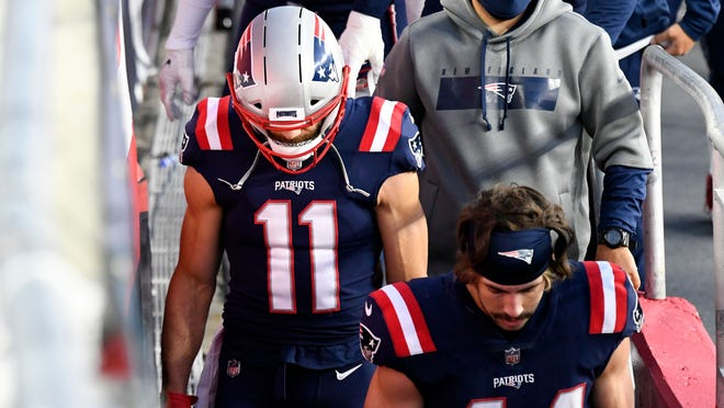 New England Patriots wide receiver Julian Edelman (11) walks into the locker room after the first half against the San Francisco 49ers at Gillette Stadium on Oct. 25, 2020.
