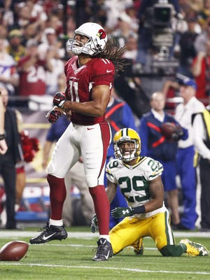 Arizona Cardinals' Larry Fitzgerald reacts after making a 19-yard pass play for a first down against the Green Bay Packers during the NFC Divisional Playoffs on Jan. 16, 2016 in Glendale, Ariz.