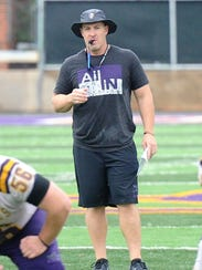 Hardin-Simmons head coach Jesse Burleson watches the