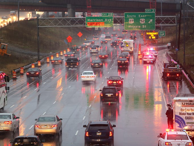 Traffic moves slowly southbound I-75 early Friday morning. For a short time, the Hopple Street exit was closed due to high water.