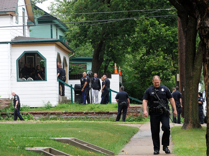 Sioux Falls Police respond to shootings at 607 West 7th Street in Sioux Falls, S.D., Wednesday, Aug., 6, 2014.