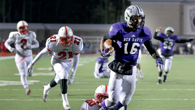 Ben Davis WR Stori Emerson is tripped into the end zone for a score by Center Grover linebacker Keith Sears in the second half of the game. Ben Davis held on to beat Center Grove 49-45 in the IHSAA semistate game Nov. 14, 2014.