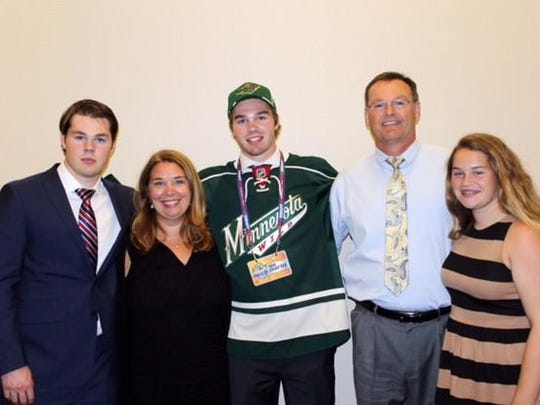 Celebrating with Nick Boka, third from left, on NHL