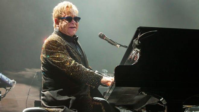 In this Nov. 30, 2013 file photo, Sir Elton John performs at the Allstate Arena in Rosemont, Ill. He'll be part of the lineup for this year's Bonnaroo Music and Arts Festival. The four-day event begins June 12 in Manchester, Tenn.