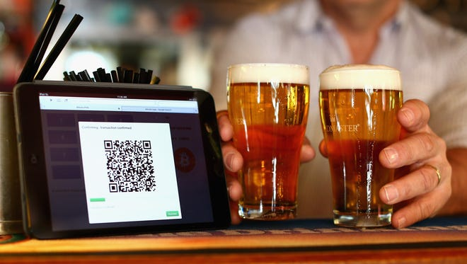 A terminal used to accept Bitcoin payments is displayed on the bar at the Old Fitzroy pub on Sept. 19, 2013, in Sydney, Australia.
