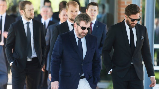 Team owner James Dolan, center, and Rangers players leave the funeral service for Martin St. Louis' mother, France, in Laval, Quebec, on Sunday.