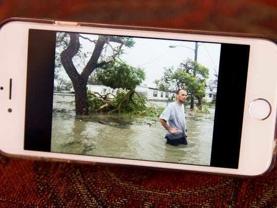 A photo taken of Devan Rewis, a 31-year lifelong Chokoloskee resident, during the aftermath of Hurricane Irma can be seen on Martha Daniels' phone, Rewis' aunt, Monday, September 18, 2017 in Chokoloskee, Fla. Rewis died in custody at NCH Downtown Baker Hospital after he was arrested on a charge of violating Collier County's curfew.