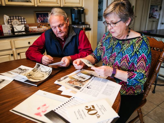 Becky and Karl Bookter look over photos from previous rodeos Wednesday, Jan. 31, 2018, at their San Angelo home.