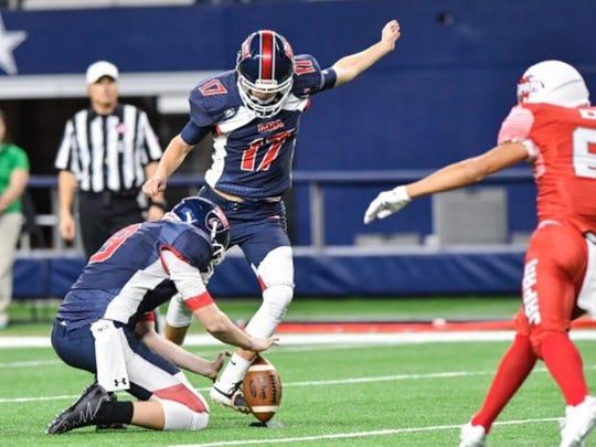 Bennett junior Stephen Oscar (17) kicks for the U.S.