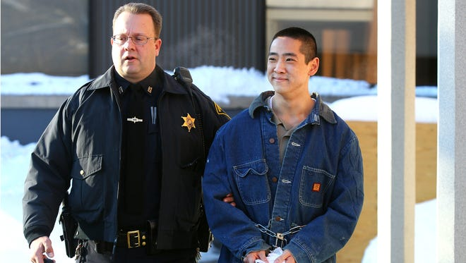 Charles Tan becomes emotional as he is led out of Pittsford Town Court after a hearing was waived when he was indicted by a grand jury on charges related to the death of his father.