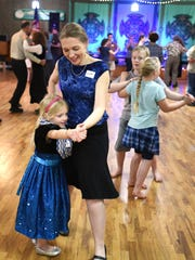 Kristen Richmond of Dallas and her daughter, Abby, 5, participate in an Irish dance hosted by Céilí of the Valley Society at the VFW Hall in Salem.