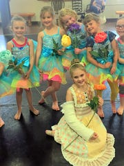 "Young ballerinas dance the part of flowers in ""Twisted Tales."""